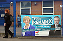 A girl walks past a 'Vote Remain' poster fixed to a school in west Belfast, County Antrim, Thursday, June 23rd, 2016, as voting got under way for the EU referendum on wether the United Kingdom should remain a member of the European Union or Leave the European Union.