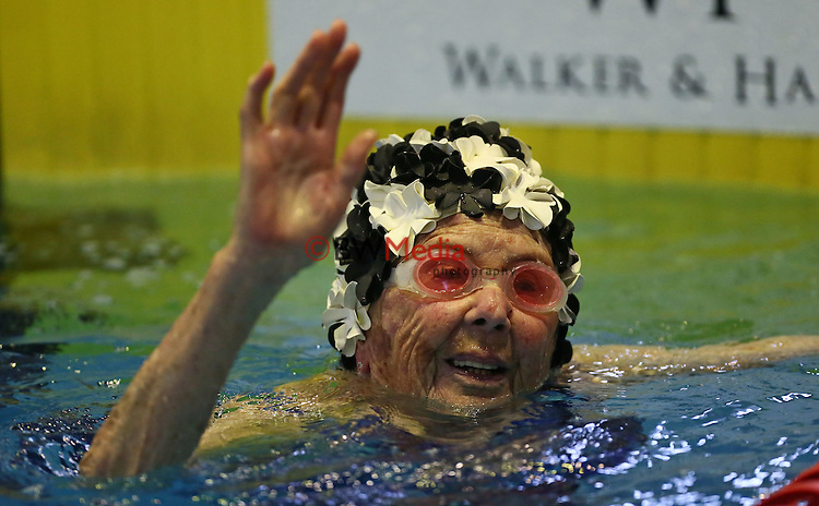 Kath Johnstone (97) at the end of the legends freestyle relay during the Swimming New Zealand Zonal Championships, Westwave Aquatic Centre, Henderson, Auckland, Sunday 8th February 2015. Photo: Simon Watts/www.bwmedia.co.nz
