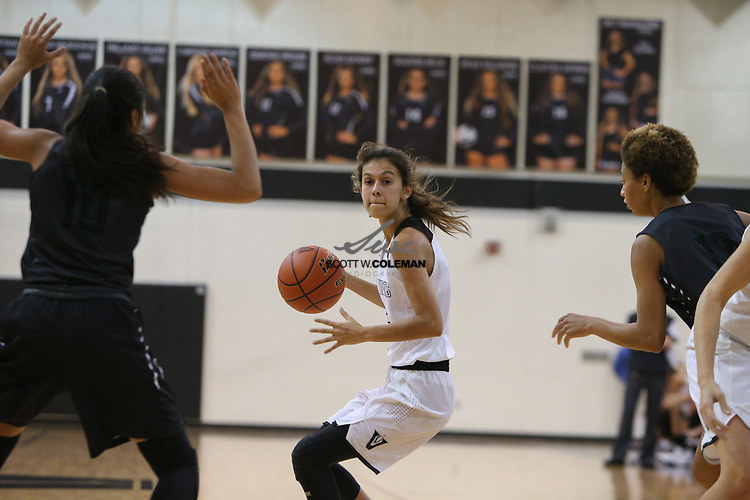 Vandegrift Vipers point guard Bee Gonzales (2) looks to pass during a girls high school basketball game between the Vandegrift Vipers and the Cedar Park Timberwolves at Vandegrift High School in Austin, Texas on November 14, 2017.