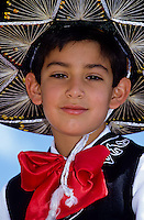 Portrait of a mexican boy in traditional dress with a big hat