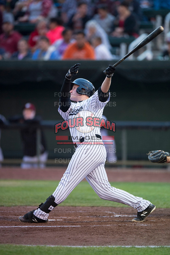Idaho Falls Chukars designated hitter Nick Hutchins (30) follows through on his swing during a Pioneer League game against the Billings Mustangs at Melaleuca Field on August 22, 2018 in Idaho Falls, Idaho. The Idaho Falls Chukars defeated the Billings Mustangs by a score of 5-3. (Zachary Lucy/Four Seam Images)