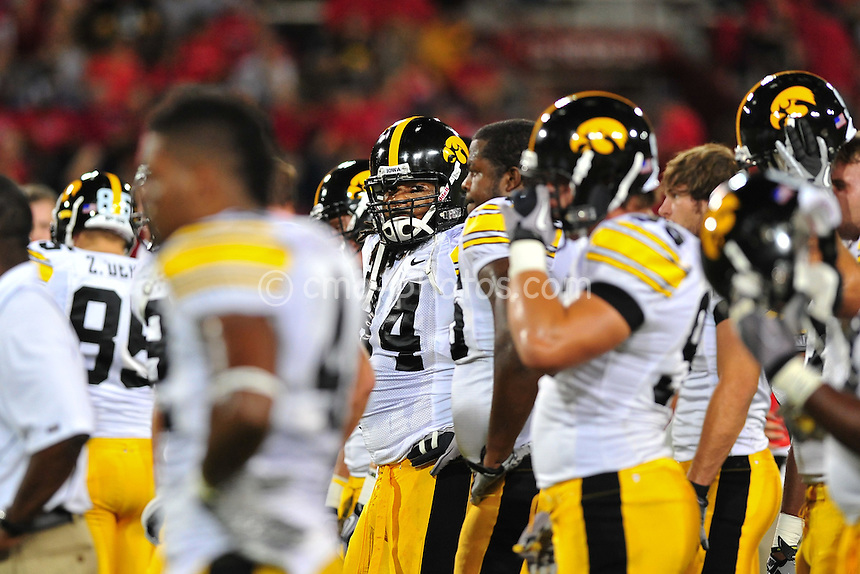 Sept 18, 2010; Tucson, AZ, USA; Iowa Hawkeyes defensive end Adrian Clayborn (94) looks over at the sidelines while his team huddles up prior to a game against the Arizona Wildcats at Arizona Stadium.