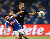 12th July 2020; Stadio San Paolo, Naples, Campania, Italy; Serie A Football, Napoli versus AC Milan; Zlatan Ibrahimovic of AC Milan challanges Mario Rui of Napoli