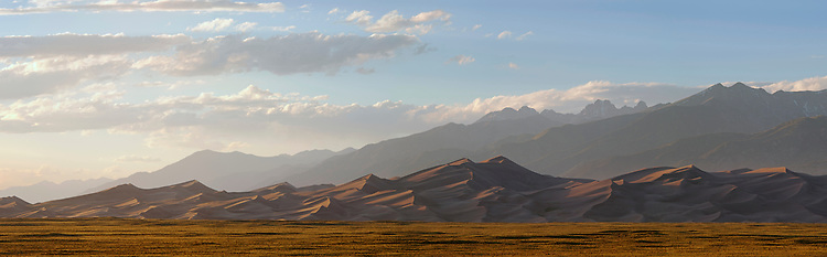 The Star Dune and surruounding sand dunes rise in front of the Crestone Peaks and the Sangre de Cristo Mountains at the Great Sand Dunes National Park, Colorado, USA
