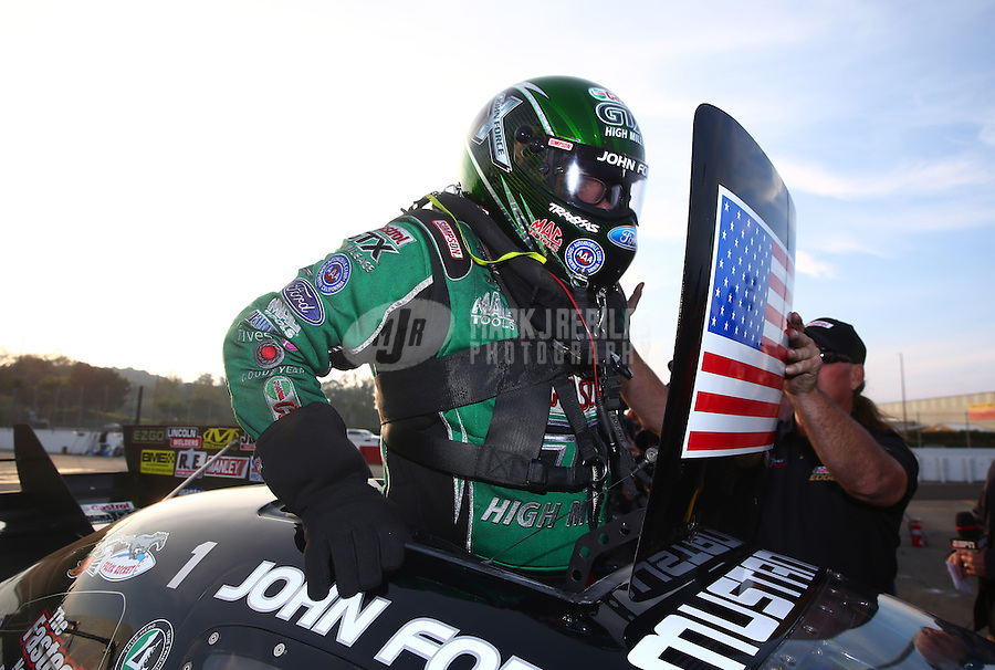 Feb 9, 2014; Pomona, CA, USA; NHRA funny car driver John Force celebrates after winning the Winternationals at Auto Club Raceway at Pomona. Mandatory Credit: Mark J. Rebilas-