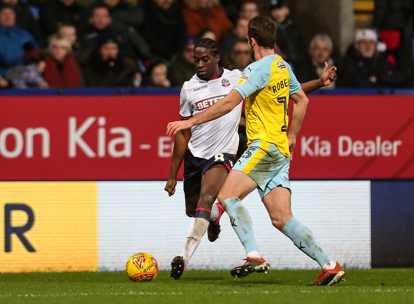 Bolton Wanderers' Clayton Donaldson competing with Rotherham United's Clark Robertson<br /> <br /> Photographer Andrew Kearns/CameraSport<br /> <br /> The EFL Sky Bet Championship - Bolton Wanderers v Rotherham United - Wednesday 26th December 2018 - University of Bolton Stadium - Bolton<br /> <br /> World Copyright © 2018 CameraSport. All rights reserved. 43 Linden Ave. Countesthorpe. Leicester. England. LE8 5PG - Tel: +44 (0) 116 277 4147 - admin@camerasport.com - www.camerasport.com