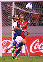 SAN JOSE, COSTA RICA - September 06, 2013: Graham Zusi (19) of the USA MNT heads the ball past Michael Umana (4) of the Costa Rica MNT during a 2014 World Cup qualifying match at the National Stadium in San Jose on September 6. USA lost 3-1.