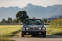 BNPS.co.uk (01202 558833)<br /> Pic: RMSotheby's/BNPS<br /> <br /> The Queens personal Daimler - fitted with special rear seats for her Corgi's comfort - has sold for £80,500 at auction.<br /> <br /> The Daimler Double Six was delivered new to Buckingham Palace in 1984 for the personal use of the monarch, then aged 58.<br /> <br /> Prior to her taking ownership of the green four door it was given a 3,000 mile road test by factory engineers to ensure it was perfect upon delivery.