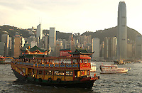 A tourist ferry crossing the Victoria Habour between Hong Kong Island and Kowloon..04-JUL-2003