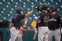 Scranton/Wilkes-Barre RailRiders Breyvic Valera (7) is congratulated by Mike Ford (36) and Kyle Higashioka (66) after hitting a home run during an International League game against the Buffalo Bisons on June 5, 2019 at Sahlen Field in Buffalo, New York.  Scranton defeated Buffalo 4-0, the second game of a doubleheader.  (Mike Janes/Four Seam Images)