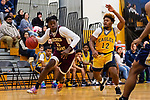 WATERBURY, CT. 09 December 2018-120918 - Sacred Heart forward Jammal Waters #11 drives to the basket past Kennedy defender Dimitri Calle #12 during the annual Waterbury Boys Basketball Jamboree at Kennedy High School in Waterbury on Sunday. Bill Shettle Republican-American
