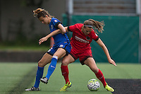 Seattle, WA - Saturday, May 14, 2016: Seattle Reign FC midfielder Lindsay Elston (6) battles Portland Thorns FC defender Katherine Reynolds (2) during first half. The Portland Thorns FC and the Seattle Reign FC played to a 1-1 tie during a regular season National Women's Soccer League (NWSL) match at Memorial Stadium.