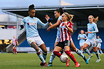 Olivia Fergusson of Sheffield United is taken down by Elisha N'Dow of Aston Villa during the The FA Women's Championship match at the Proact Stadium, Chesterfield. Picture date: 12th January 2020. Picture credit should read: James Wilson/Sportimage