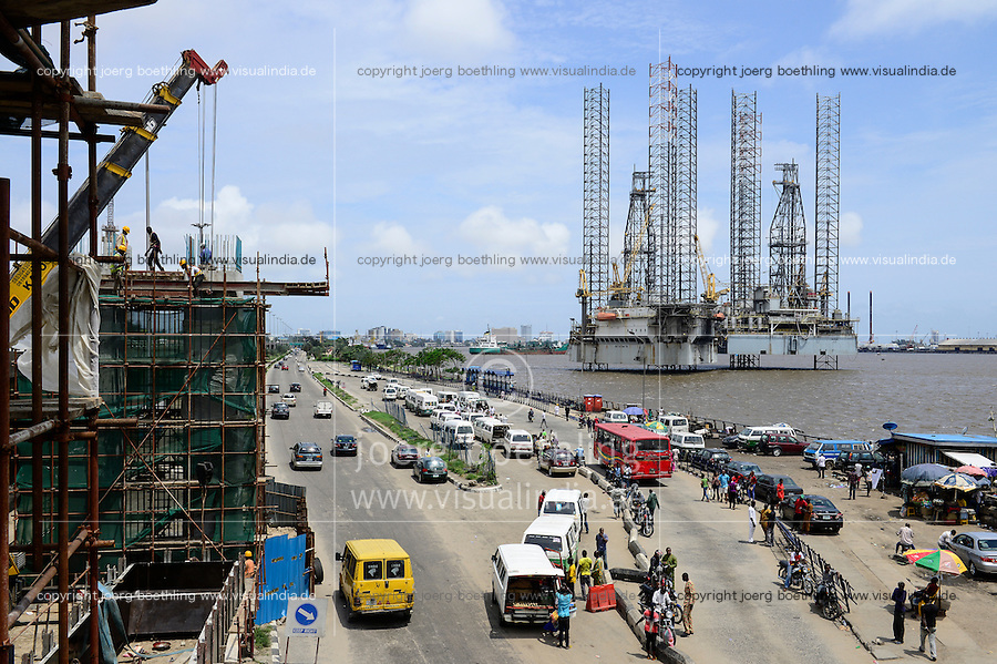 NIGERIA, City Lagos, two oil platform laying in Lagos port, Oritsetimeyin and Onome, and left  flyover construction for new metro train by chinese company CHINA CIVIL CCECC, road traffic with VW minibus