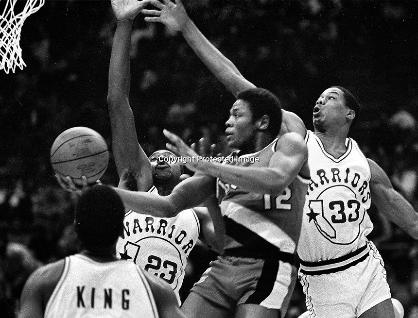 Portland vs. Golden State Warriors...Billy Ray Bates drives against Warriors Rickey Brown and Sam Williams...(1982 photo/Ron Riesterer)