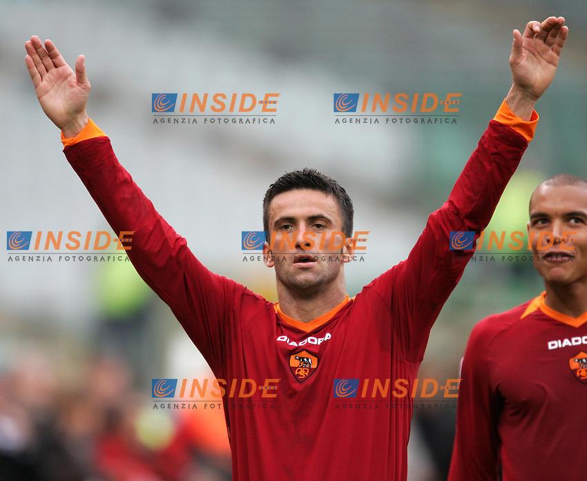 Christian Panucci celebrates after scoring third goal for As Roma. Esultanza di Christian Panucci dopo aver segnato il terzo gol per la Roma<br /> Italian &quot;Serie A&quot; 2006-07<br /> 25 Feb 2007 (Match Day 25)<br /> Roma-Reggina (3-0)<br /> &quot;Olimpico&quot;-Stadium-Roma-Italy<br /> Photographer: Andrea Staccioli INSIDE