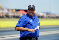 Sept. 22, 2012; Ennis, TX, USA: NHRA National Dragster Photographer Jerry Foss grabs a wrench for his toolbox during qualifying for the Fall Nationals at the Texas Motorplex. Mandatory Credit: Mark J. Rebilas-