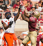 Florida State defensive back Derwin James, right, breaks up a Syracuse pass intended for Steve Ishmael in the 1st half of an NCAA college football game in Tallahassee, Fla., Saturday, Nov. 4, 2017.  (AP Photo/Mark Wallheiser)