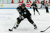BOSTON, MA - JANUARY 11: Neve Van Pelt #10 of Providence College passes the puck during a game between Providence College and Boston University at Walter Brown Arena on January 11, 2020 in Boston, Massachusetts.