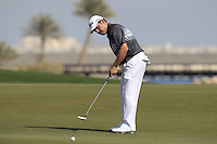 Louis Oosthuizen (RSA) putts on the par3 13th green during Friday's Round 3 of the Commercial Bank Qatar Masters 2013 at Doha Golf Club, Doha, Qatar 25th January 2013 .Photo Eoin Clarke/www.golffile.ie