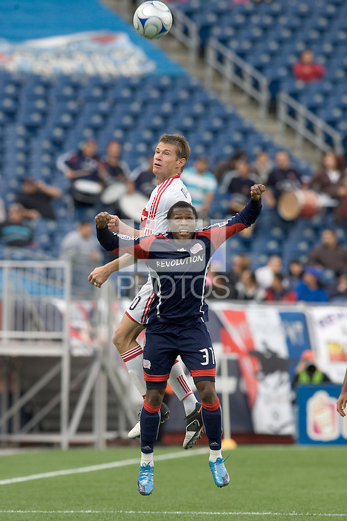 Chicago Fire forward Brian McBride (20) and New England Revolution midfielder Sainey Nyassi (31) battle for head ball. The New England Revolution out scored the Chicago Fire, 2-1, in Game 1 of the Eastern Conference Semifinal Series at Gillette Stadium on November 1, 2009.