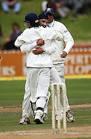 Indian captain MS Dhoni hugs Harbahjan Singh after the dismissal of Jesse Ryder for a duck during day four of the 3rd test between the New Zealand Black Caps and India at Allied Prime Basin Reserve, Wellington, New Zealand on Monday, 6 April 2009. Photo: Dave Lintott / lintottphoto.co.nz.
