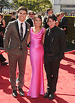 LOS ANGELES, CA - SEPTEMBER 15: Luke Bilyk, Cristine Prosperi and Ricardo Hoyos. arrive at the 2012 Primetime Creative Arts Emmy Awards at Nokia Theatre L.A. Live on September 15, 2012 in Los Angeles, California.
