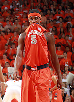 Syracuse forward C.J. Fair (5) sees the writing on the wall as Virginia defeated Syracuse 75-56 in an NCAA basketball game Saturday March 1, 2014 in Charlottesville, VA.