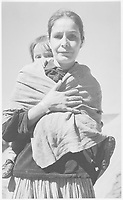 """Diné Woman and Child, Canyon de Chelle, Arizona."""" [Canyon de Chelly National Monument] (vertical orientation);<br /> From the series Ansel Adams Photographs of National Parks and Monuments, compiled 1941 - 1942, documenting the period ca. 1933 - 1942.<br /> Date <br /> <br /> 1941"""