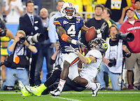 Jan 10, 2011; Glendale, AZ, USA; Auburn Tigers safety Zac Etheridge (4) breaks up a pass intended for Oregon Ducks wide receiver Jeff Maehl (23) during the second half of the 2011 BCS National Championship game at University of Phoenix Stadium.  Mandatory Credit: Mark J. Rebilas-