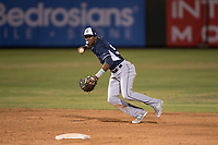 AZL Padres 2 shortstop Jordy Barley (55) prepares to make a throw to first base during an Arizona League game against the AZL Angels at Tempe Diablo Stadium on July 18, 2018 in Tempe, Arizona. The AZL Padres 2 defeated the AZL Angels 8-1. (Zachary Lucy/Four Seam Images)