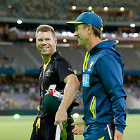 8th November 2019; Optus Stadium, Perth, Western Australia Australia; T20 Cricket, Australia versus Pakistan; David Warner shares a laugh with Justin Langer after Australia defeated Pakistan - Editorial Use