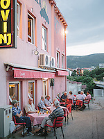 Locals flock outside a cafe near the bank of Neretva River in Mostar.
