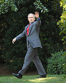 Washington, D.C. - July 24, 2007 -- United States President George W. Bush waves to cameras as he departs the South Lawn of the White House in Washington, D.C. on Tuesday, July 24, 2007 aboard Marine 1 to visit Charleston Air Force Base, Charleston, South Carolina.<br /> Credit: Ron Sachs / Pool via CNP