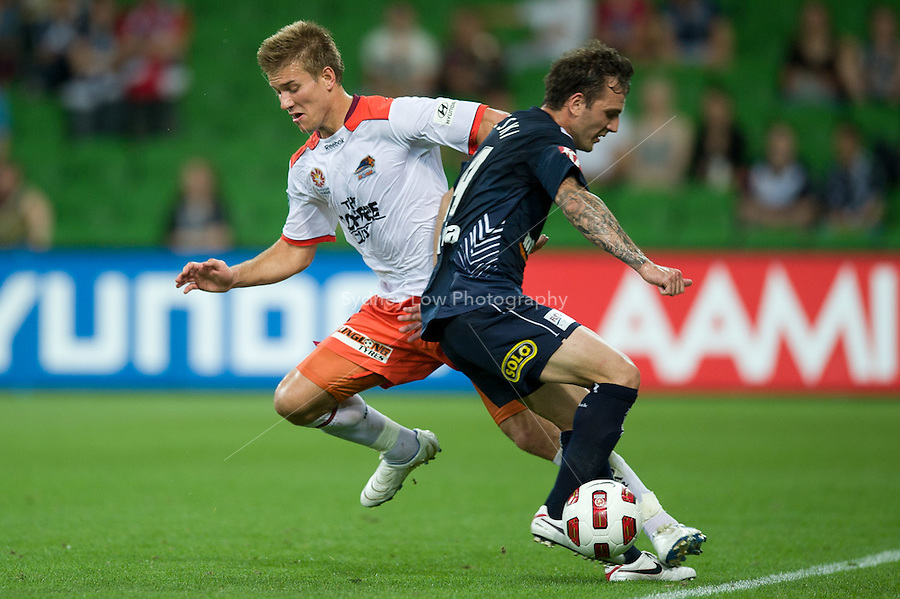 MELBOURNE, AUSTRALIA - DECEMBER 03: Billy Celeski of the Victory challenges Erik Paartalu of the Roar during the round 17 A-League match between the Melbourne Victory and the Brisbane Roar at AAMI Park on December 3, 2010 in Melbourne, Australia. (Photo by Sydney Low / Asterisk Images)