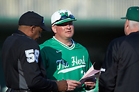 Marshall Thundering Herd head coach Jeff Waggoner (center) meets with Charlotte 49ers head coach Loren Hibbs (right) and home plate umpire Reid Churchill prior to their game at Hayes Stadium on March 22, 2019 in Charlotte, North Carolina. The Thundering Herd defeated the 49ers 12-6. (Brian Westerholt/Four Seam Images)