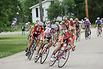 2007 Burlington Road Race - The peloton snakes through the streets of Mediapolis the second turn around.