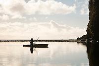 A female kayaker in Five Mile Creek - Westland National Park, West Coast, New Zealand