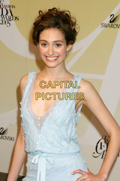 EMMY ROSSUM.2005 CFDA Fashion Awards - Inside Arrivals.New York Public Library in New York City, New York, USA, June 6th 2005 .half length pale blue dress buttons bow.Ref: IW.www.capitalpictures.com.sales@capitalpictures.com.©Ian Wilson/Capital Pictures.