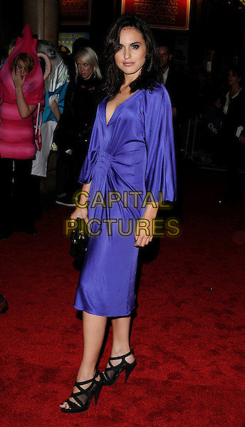 "VERONICA ECHEGUI.Attending ""The Bunny & The Bull"" Gala Screening during the Times BFI 53rd London Film Festival, Vue West End, Leicester Square, London, England, 23rd October 2009..full length blue purple dress sleeves ruched black sandals open toe clutch bag low cut .CAP/CAN.©Can Nguyen/Capital Pictures"