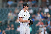 Charlotte Knights starting pitcher Scott Carroll (29) looks to his catcher for the sign against the Syracuse Chiefs at BB&T BallPark on June 1, 2016 in Charlotte, North Carolina.  The Knights defeated the Chiefs 5-3.  (Brian Westerholt/Four Seam Images)