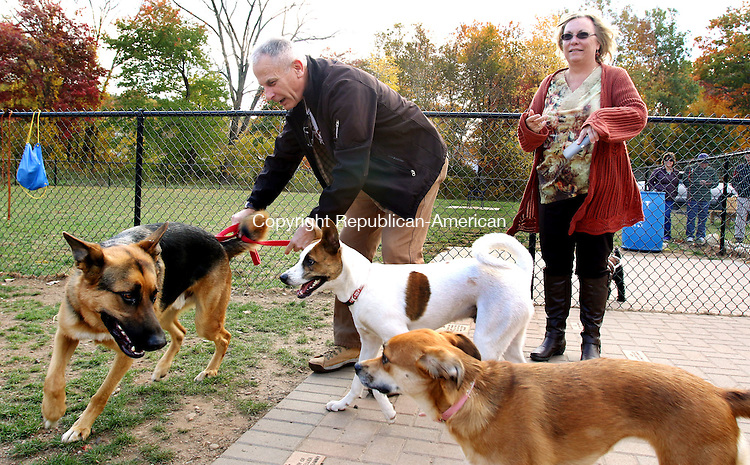 WOLCOTT CT. 17 October 2015-101715SV01-Chris and Lori Grice of Wolcott play with their dog during the grand opening of the dog park on Mad River Road in Wolcott Saturday.<br /> Steven Valenti Republican-American