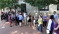 People wait to enter the Paramount Theater for a memorial for Heather Heyer Wed., August 16, 2017, in Charlottesville, Va. Heyer was killed the previous weekend when a vehicle drove into a crowd of counter-protestors after the Unite The Right rally. Photo/Andrew Shurtleff