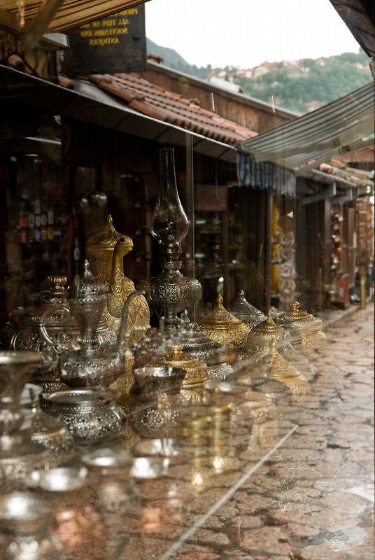The various vendors in old Sarajevo are organized into alleys specializing in similar goods, such as the copper items shown in this storefront.