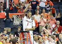 Virginia guard Justin Anderson (1) cuts his piece of net to celebrate winning the ACC title after defeating Syracuse 75-56 Saturday March 1, 2014 during an NCAA basketball game in Charlottesville, VA.