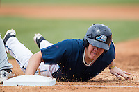 West Michigan Whitecaps first baseman Josh Lester (30) dives back to first base against the Dayton Dragons on April 24, 2016 at Fifth Third Ballpark in Comstock, Michigan. Dayton defeated West Michigan 4-3. (Andrew Woolley/Four Seam Images)