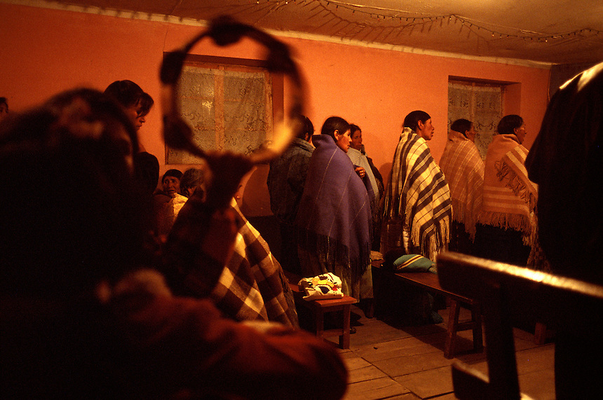 Singing in their native Aymara language, Indian members of a tiny Assembly of God congregation worship in Villa el Carmen, Bolivia. Long disassociated with its North American counterpart, the Bolivian Assembly of God church has taken on the face of the majority Indian population in the country.