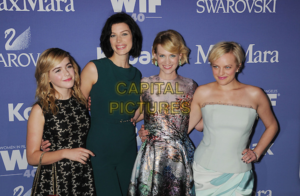 Kiernan Shipka, Jessica Pare, January Jones, Elizabeth Moss of Mad Men <br /> arriving at Women In Film's 2013 Crystal and Lucy Awards at The Beverly Hilton Hotel in Beverly Hills, California, USA, June 12th, 2013.<br /> half length sixties midi mid dress print grey gray green tree landscape purple cast co-stars actresses actors black dress red bag handbag strapless corset blue pastel print catsuit jumpsuit belt <br /> CAP/ROT/TM<br /> &copy;Tony Michaels/Roth Stock/Capital Pictures