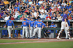 OMAHA, NE - JUNE 26: University of Florida players celebrate after scoring against Louisiana State University during the Division I Men's Baseball Championship held at TD Ameritrade Park on June 26, 2017 in Omaha, Nebraska. The University of Florida defeated Louisiana State University 4-3 in game one of the best of three series. (Photo by Justin Tafoya/NCAA Photos via Getty Images)