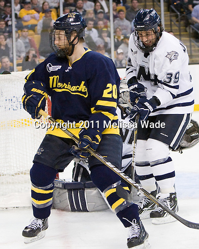 Ryan Flanigan (Merrimack - 20), Phil DeSimone (UNH - 39) - The Merrimack College Warriors defeated the University of New Hampshire Wildcats 4-1 (EN) in their Hockey East Semi-Final on Friday, March 18, 2011, at TD Garden in Boston, Massachusetts.